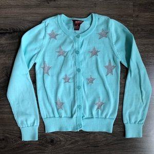 light blue cardigan with glittery silver stars